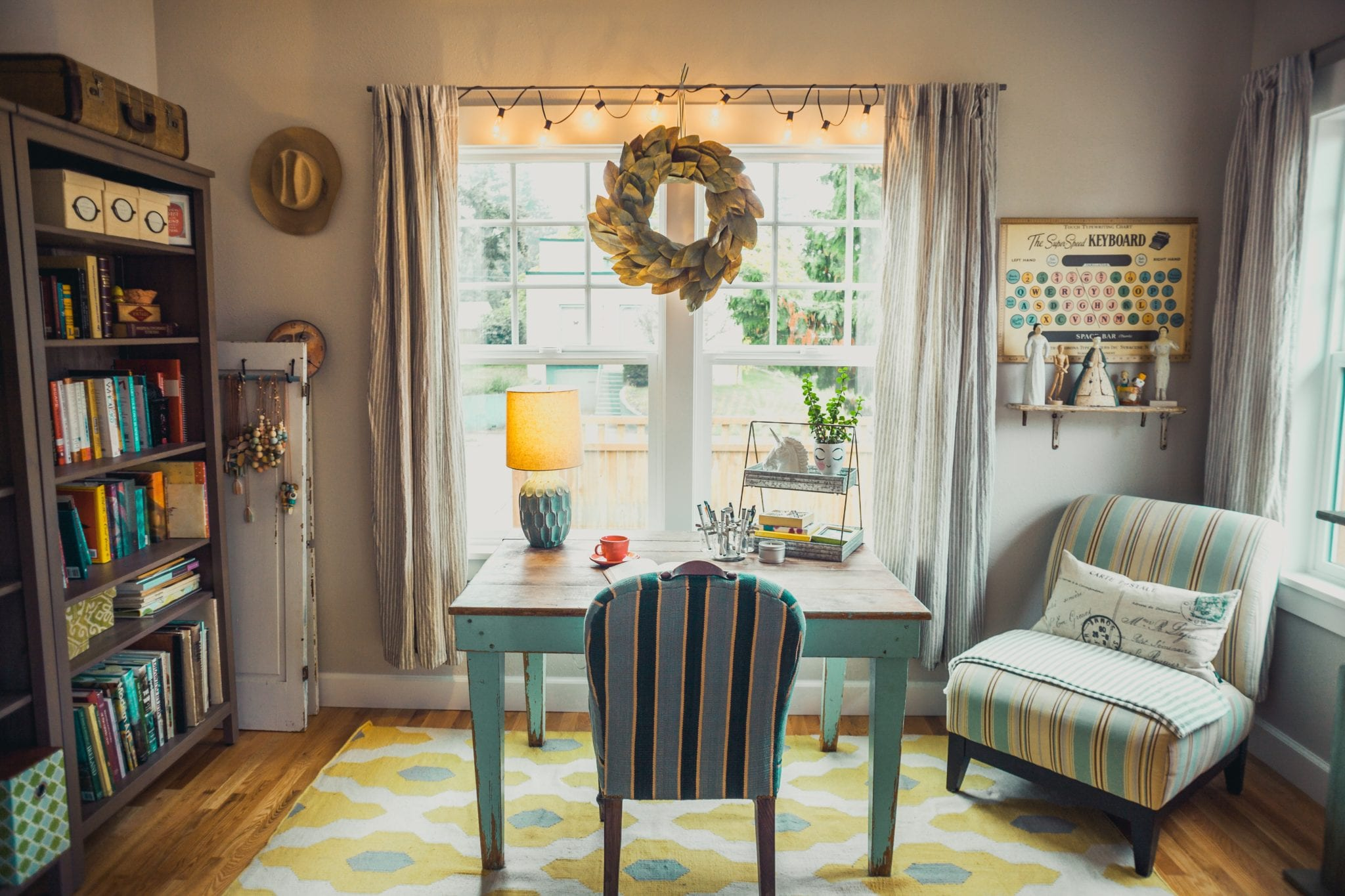 beige table lamp on table with chair in room by window