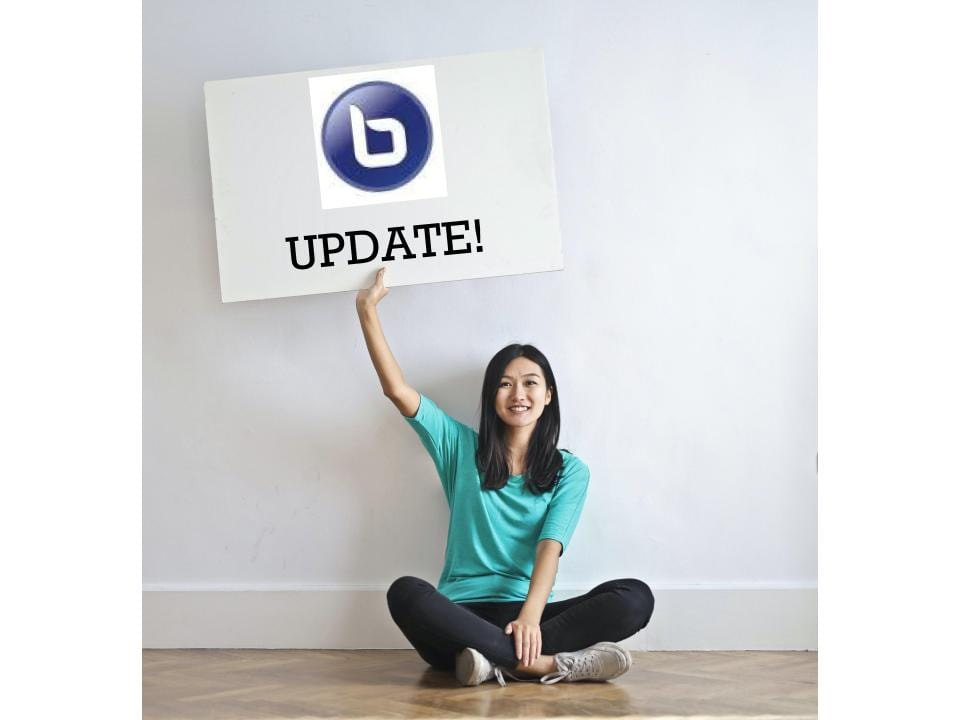 girl holding a sign that says bigbluebutton update