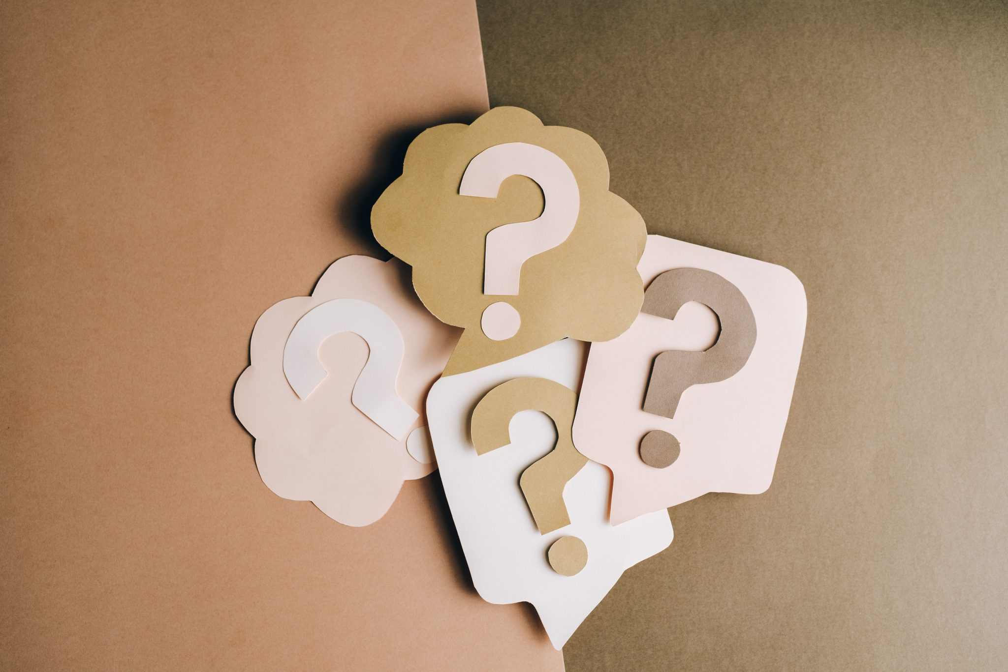 cut out question marks on paper